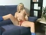Blonde chick pleasuring herself on this home video