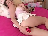 Charlotte masturbating in bed with dildo