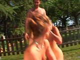 Assfucking threesome on the grass