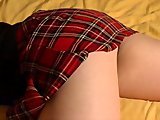 Blond Lili in a plaid skirt and black panties