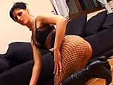Alicia in fishnets with collar and chain