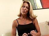 Blonde Milf fills her pussy with a huge toy