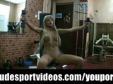 Hot blonde doing nude fitness exercises at gym