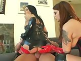 Two chicks in pvc share cock