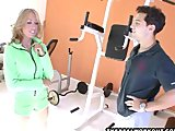 Busty blonde fitness trainer is fucked by her student in the gym