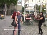 Hot redhead has fun in streets