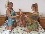 Two lesbian trainers seduce shy girl