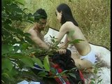 Young couple having sex in the bushes
