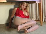 Pantyhose queein posses under the table