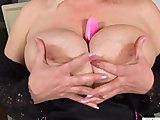 Big titted blonde fucks and sucks her dildo.