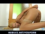 Playful blonde pounds her bald twat