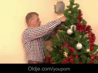 Xmas tree adorning ends with hot oldyoung fuck